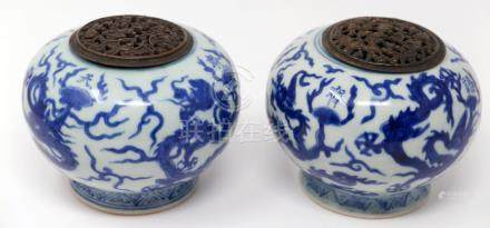 A pair of late 18th / early 19th century Chinese blue and white porcelain incense burners, decorated