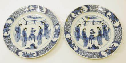 A pair of Chinese Kangxi period blue and white plates, figural design, Diameter 20cm (one restored)