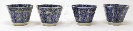 A set of four Chinese Kangxi period blue and white octagonal cups, floral design, H.6 W.7 D.7cm