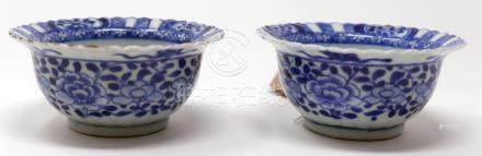 A pair of Chinese Kangxi period blue and white cups, figural and floral design, H.4cm Diameter 9cm