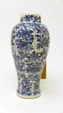 A Chinese Kangxi period blue and white vase, floral decoration, H.18cm (hairline crack)
