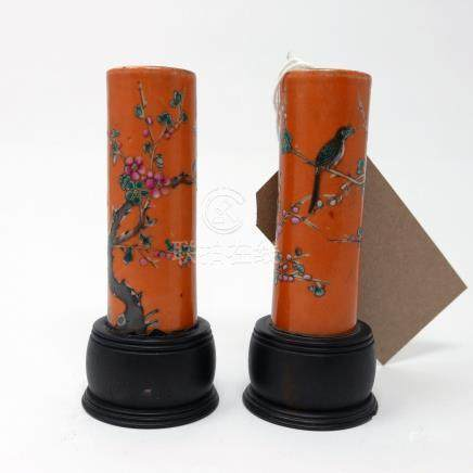 A pair of early 19th century Chinese bud vases, flora and fauna design on an orange ground, with