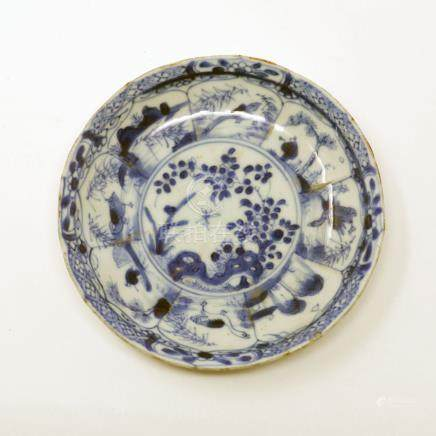 An 18th century Chinese blue and white dish, prunus design, figural border, Diameter 14cm