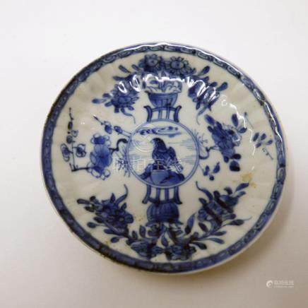 An 18th century Chinese blue and white dish, with central hawk design within floral border, Diameter