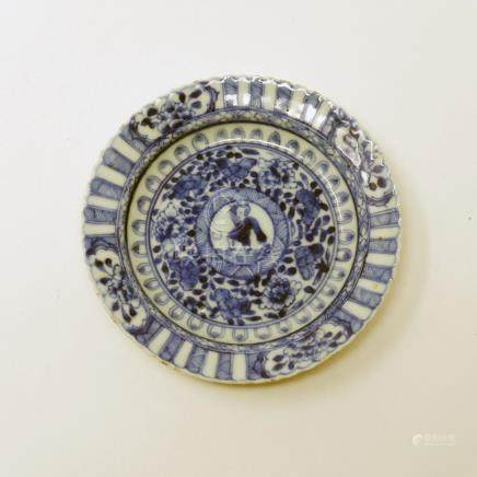 An 18th century Chinese blue and white scalloped dish, central figural design within floral