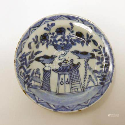 An 18th century Chinese blue and white dish, two birds over house design, Diameter 10cm