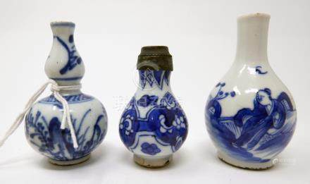 Three 18th century Chinese blue and white miniature vases, tallest H.8cm