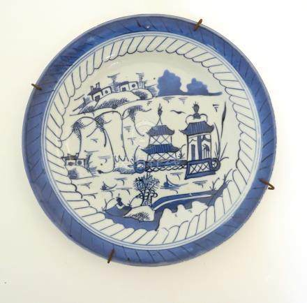 An 18th/19thC Anglo-Chinese blue and white hand-painted plate,