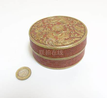 A Chinese burnt orange circular inkstone / pot,