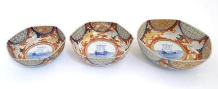A graduated set of three hexagonal Japanese Fukagawa Seiji bowls decorated with stylised cranes
