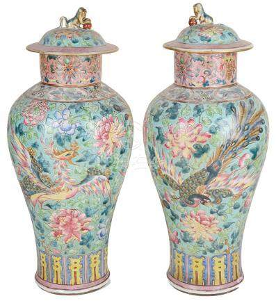 A pair of Chinese famille rose vases with domed lids: 19th century,