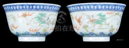 Two Chinese Famille Rose Cups: 19th century, decorated with dragons chasing flaming pearls.