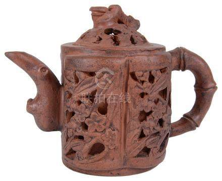 A Chinese Yixing teapot with cover 20th century Of a four-lobed shape with openwork decoration of