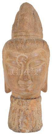 A Stone Buddha's Head: Chinese/Tibetan, the face with meditative expression flanked by long ears,