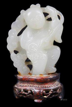A Chinese jade carving possibly 18th/19th century Of a light celadon green tone with waxy lustre.