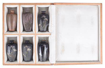 A Set of Six Japanese Miniature Vases: Each vase representing a different stage in the production