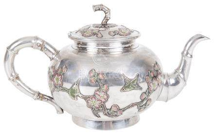 A Chinese silver teapot Late 19th century With stylised bamboo-shaped spout, handle and lid finial.
