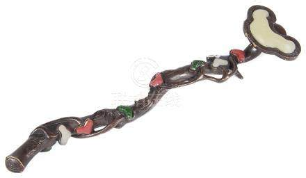A Chinese bronze sceptre In the shape of a sinuous leafy branch with lingzhi mushroom.