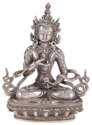 A Tibetan silver Bodhisattva 18th/19th century Accurately modelled in an elegant seated pose on a