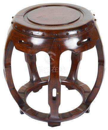 A Chinese Opium Stool: Hardwood, in the form of a barrel,