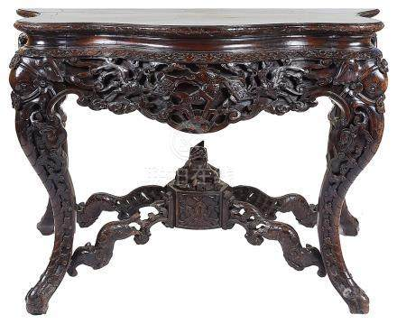 A Chinese Table: Hardwood, heavily carved throughout with phoenix and carp designs.