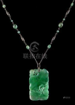 A large Chinese carved jadeite lotus pendant with diamond set suspension loop, on later associated