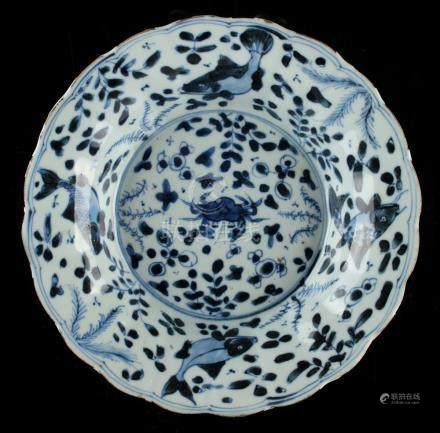 Property of a lady - a Chinese blue & white petal rimmed dish, Kangxi period (1662-1722), painted