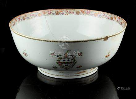 A Chinese famille rose armorial punch bowl, Qianlong period (1736-1795), painted to either side with