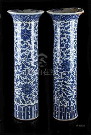 A large pair of Chinese blue & white sleeve vases, 19th century, painted with scrolling lotus,