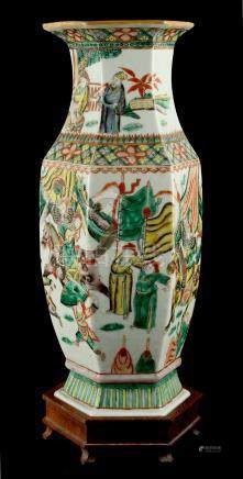 A late 19th century Chinese famille verte hexagonal baluster vase, painted with warriors in