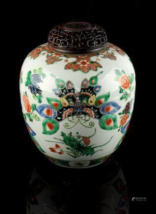 A Chinese famille verte ovoid ginger jar, late 19th century, painted with butterflies among