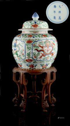 Property of a lady - a Chinese wucai ovoid ginger jar & cover, painted with four panels of