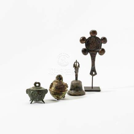 A collection of two bronze Chinese bells, a Chinese rattle a