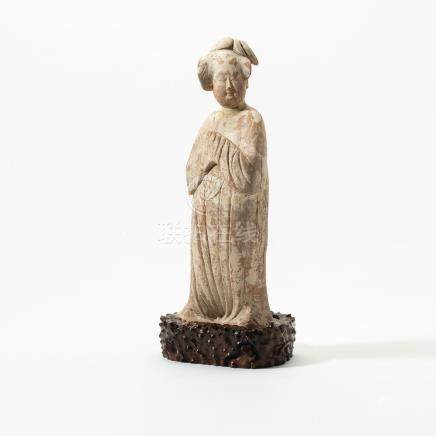 A Chinese pottery figure of a fat lady