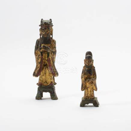 Two Chinese gilt-, red- and black-lacquered bronze figures o