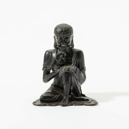 A rare Chinese bronze figure of the ascetic Buddha Shakyamun