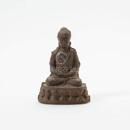 A Chinese iron figure of Buddha Shakyamuni