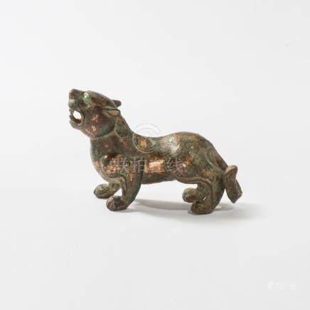 An important Chinese gilt-bronze figure of a tiger