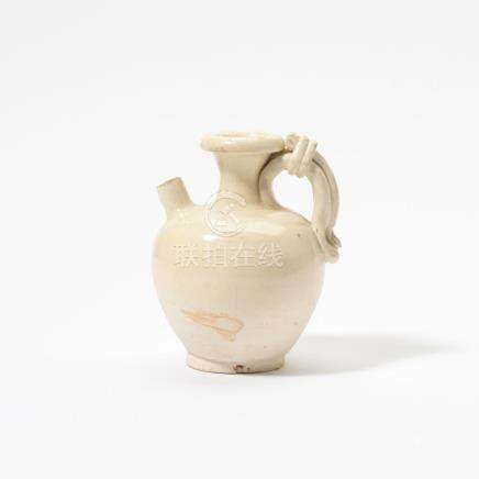 A Chinese white-glazed ewer