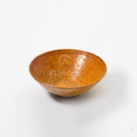 A Chinese amber-glazed moulded pottery bowl