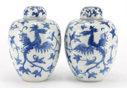 Pair of Chinese blue and white porcelain jars and covers, each hand painted with two phoenixes