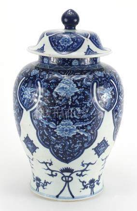 Large Chinese blue and white porcelain baluster jar and cover, hand painted with flowers and
