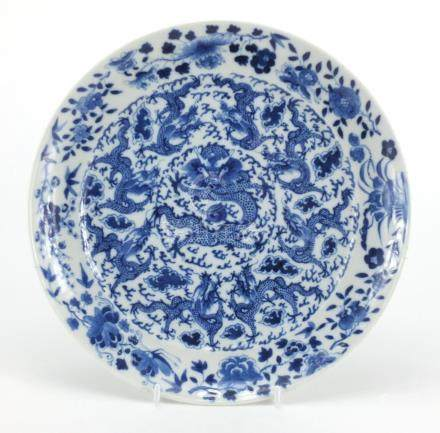 Chinese blue and white porcelain plate, hand painted with dragons amongst clouds, chasing the