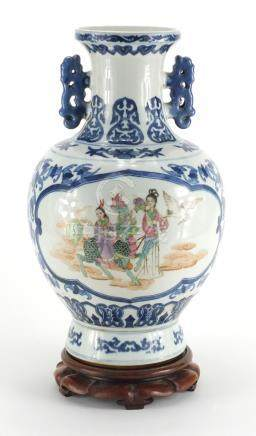 Chinese blue and white porcelain vase, with twin handles raised on hardwood stand, the two central