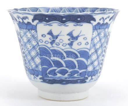 Chinese blue and white porcelain fluted tea bowl, hand painted with panels of birds and flowers,