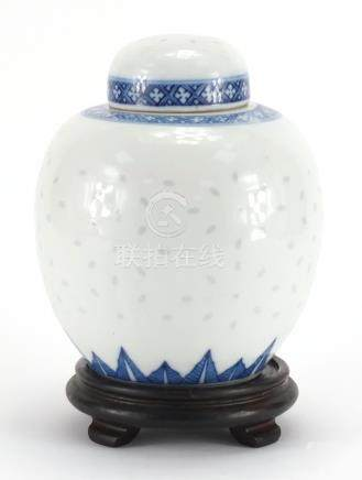 Chinese blue and white porcelain ginger jar and cover on hardwood stand, blue ring marks to the