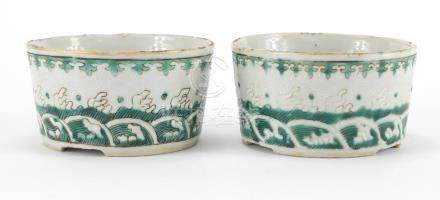 Pair of Chinese porcelain brush washers, hand painted in green and incised with crashing waves,