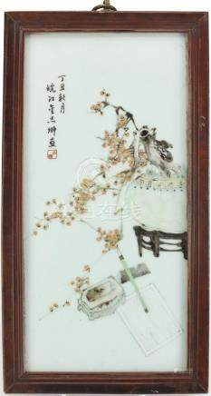 Chinese porcelain panel housed in a hardwood hanging frame, hand painted with a scholar's brush