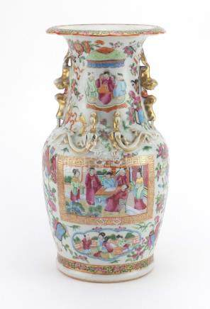 Chinese porcelain Canton vase with twin handles and relief dragon decoration, finely hand painted in