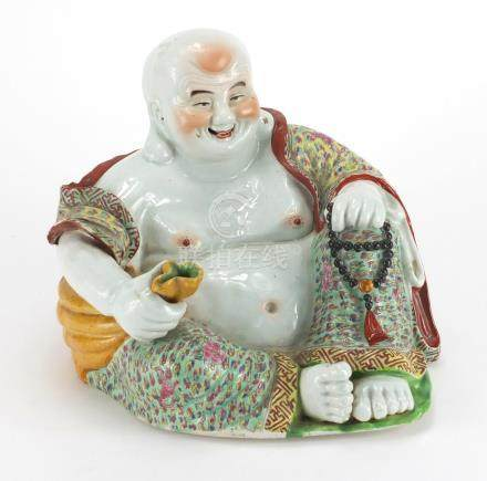 Chinese porcelain figure of Buddha holding a sack, finely hand painted in the famille rose
